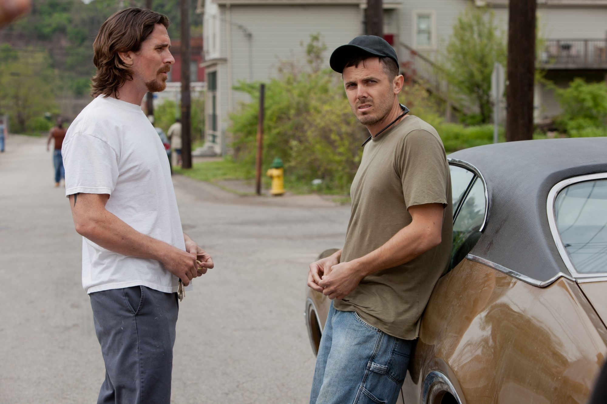"Christian Bale, left, and Casey Affleck play estranged brothers in ""Out of the Furnace."""