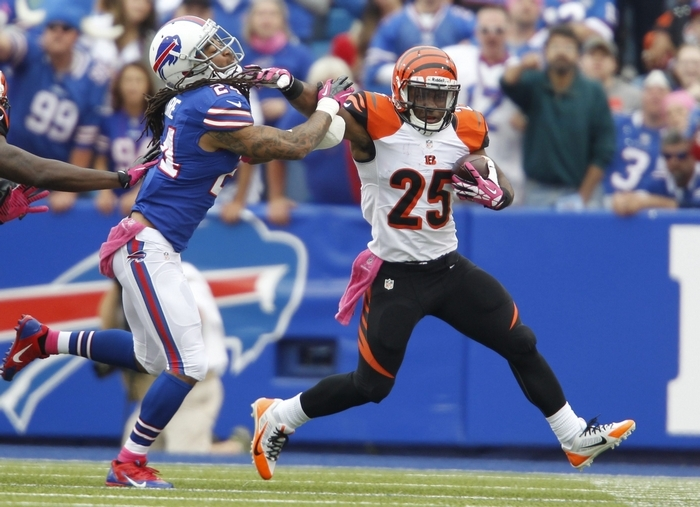 Bills cornerback Stephon Gilmore, in his first game of the season,  gets a stiff arm while trying to tackle Bengals running back Giovani Bernard in the first quarter. (Harry Scull Jr./Buffalo News)