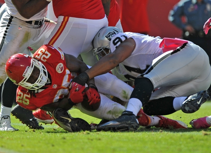 Kansas City running back Jamaal Charles dives into the end zone for a TD against Oakland defender Jack Crawford. (Getty Images)
