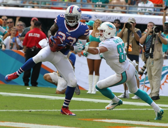 Bills free safety Aaron Williams (23) intercepts the ball  in front of Miami wide receiver Brian Hartline (82) in the first quarter. (James P. McCoy/Buffalo News)