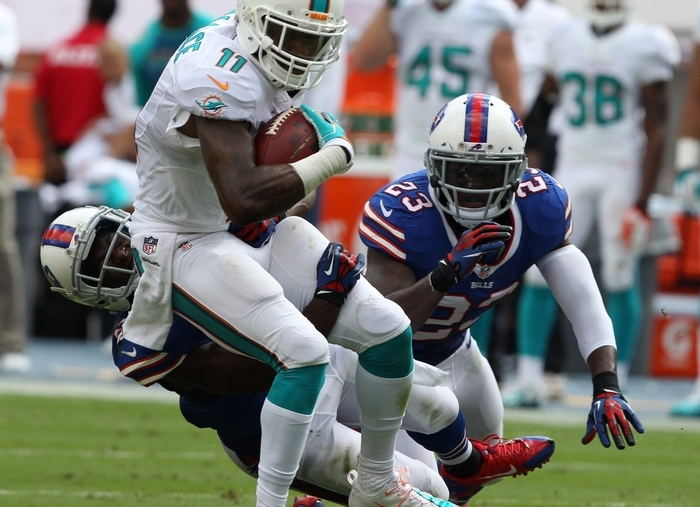 Dolphins receiver Mike Wallace is brought down by Bills cornerback Leodis McKelvin in the second quarter. (James P. McCoy/Buffalo News)