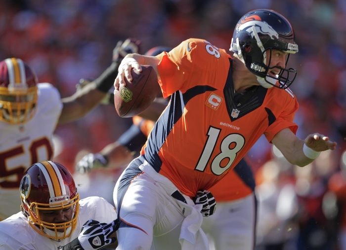 Broncos quarterback Peyton Manning (18), here shown running with the ball, is the early favorite to win the league's most valuable player award. (Associated Press)