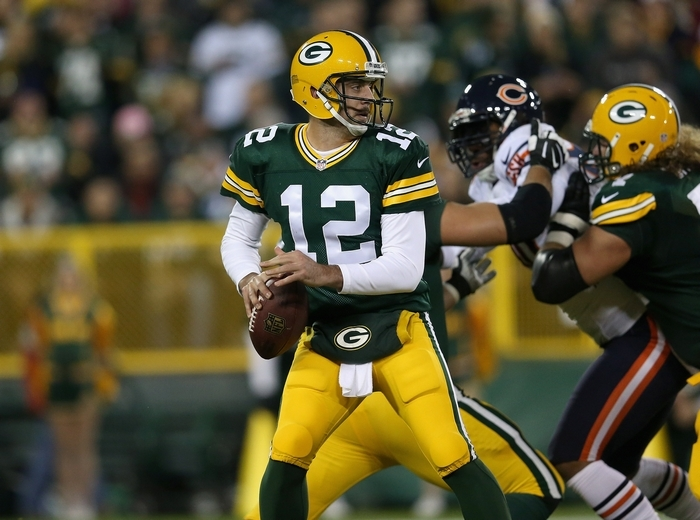 The absence of star quarterback Aaron Rodgers because of a broken collarbone could lead to Green Bay being unseated by Chicago or Detroit as NFC North champion. (Getty Images)