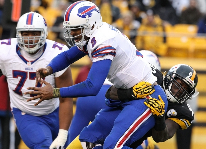 Bills quarterback EJ Manuel is hauled down by Steelers free safety Ryan Clark in the fourth quarter. Manuel had his worst game of the season on Sunday. (James P. McCoy/Buffalo News)