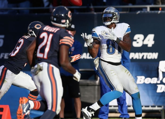 Lions receiver Calvin Johnson makes the game-winning touchdown catch over Charles Tillman (33) and Major Wright (21) of the Bears during Sunday's game at Soldier Field. (Getty Images)