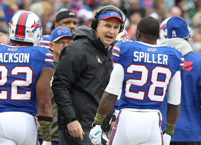 Bills coach Doug Marrone counsels C.J. Spiller on the sideline during the second quarter. Spiller had just 6 rushing yards on the day. (James P. McCoy/Buffalo News)