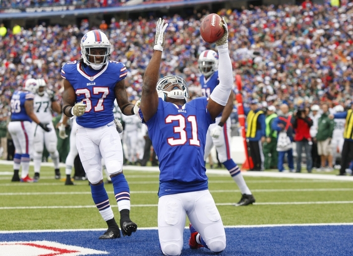 Bills safety Jairus Byrd celebrates after intercepting a Geno Smith pass deep in Jets' territory. The play set up a field goal that put the Bills ahead, 20-0, at halftime. (Harry Scull Jr/Buffalo News)