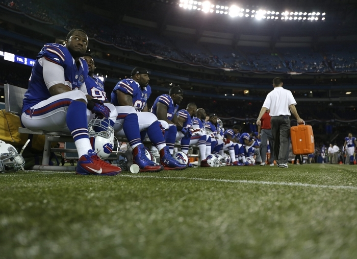 Bills players sit on the bench at the end of their 50-17 loss to the Seattle Seahawks last season. (Associated Press)