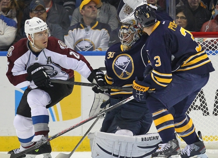 The Sabres' Ryan Miller, shown making a save on Colorado's Paul Stastny, may be tough to move to another team in the middle of the season. (Mark Mulville / Buffalo News)