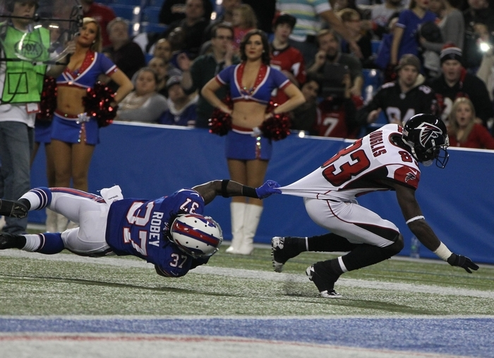 Atlanta wide receiver Harry Douglas is tackled just short of the goal line by Buffalo's Nickell Robey in the third quarter. (James P. McCoy/Buffalo News)