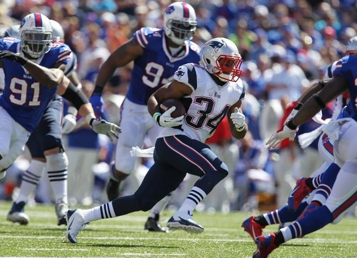 The Patriots' Shane Vereen runs through the Bills defense in the second quarter in Orchard Park Sunday, September 8, 2013.  (Mark Mulville/Buffalo News)