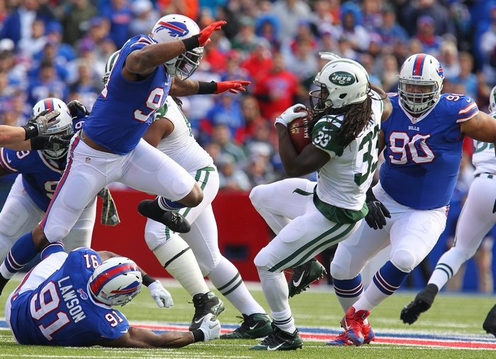 The Bills' Manny Lawson, Mario Williams, and Alan Branch surround the Jets' Chris Ivory in the first quarter at Ralph Wilson Stadium in Orchard Park Sunday, November 17, 2013.  (Mark Mulville/Buffalo News)