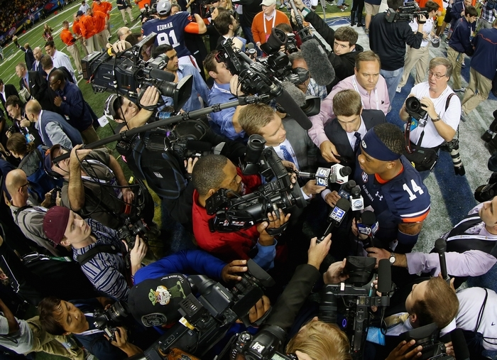 ATLANTA, GA – DECEMBER 07:  Quarterback Nick Marshall #14 of the Auburn Tigers is interviewed by the media after defeating the Missouri Tigers 59-42 to win the SEC Championship Game at Georgia Dome on December 7, 2013 in Atlanta, Georgia.  (Photo by Mike Ehrmann/Getty Images)