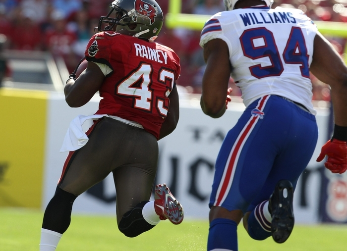 Tampa Bay Buccaneers running back Bobby Rainey scores an an 80-yard touchdown run past Bills defensive end Mario Williams in the first quarter. (James P. McCoy/Buffalo News)