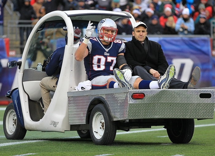 Rob Gronkowski of the New England Patriots leaves the field in the third with an apparent knee injury. (Getty Images)