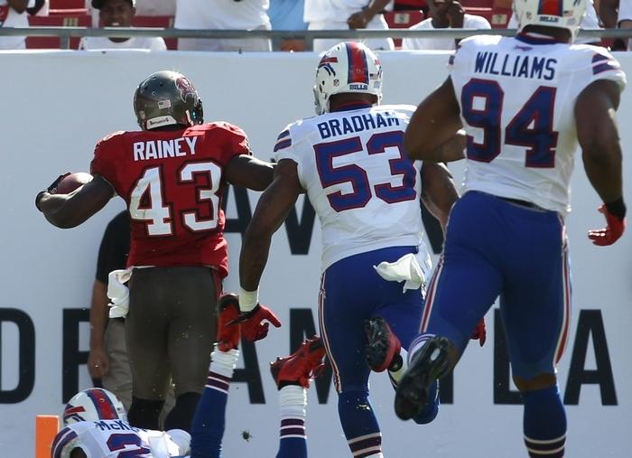 Tampa Bay running back Bobby Rainey (43) runs past Bills cornerback Leodis McKelvin (21) as he scores on an 80-yard play Sunday. (James P. McCoy/ Buffalo News)