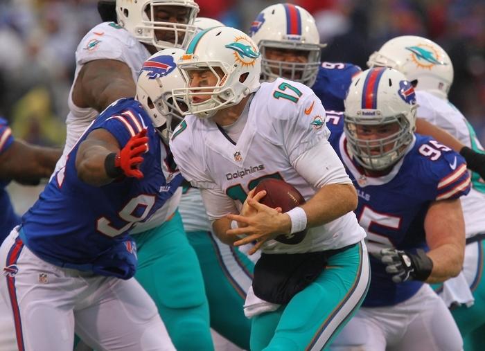 That's a wrap! Buffalo's Mario Williams grabs Miami quarterback Ryan Tannehill for one of the Bills' seven sacks. The Bills' season total is a team-record 56 sacks. (Mark Mulville/Buffalo News)