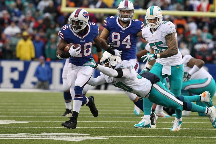 ABOVE: Bills running back C.J. Spiller rushes for a first down as Dolphins safety Chris Clemons tries to bring him down. BELOW: Bills quarterback Thad Lewis drops back to pass. Lewis, filling in for the injured EJ Manuel, kept turnovers to a minimum while beating Miami for the second time this season.