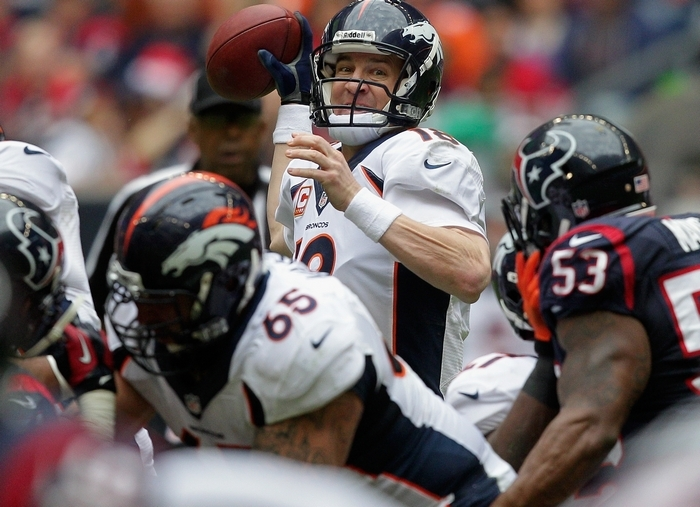 Broncos quarterback Peyton Manning connected for his 51st touchdown pass of the season, an NFL record. (Getty Images)