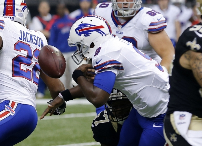 Thad Lewis has been serviceable but turnover prone when filling in at quarterback for injured rookie EJ Manuel. (AP Photo/Bill Haber)