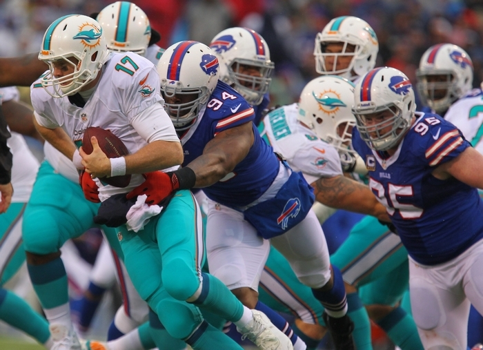 The Bills' Mario Williams gets one of his 13 sacks this season as he wraps up the Dolphins' Ryan Tannehill. (Mark Mulville/Buffalo News)