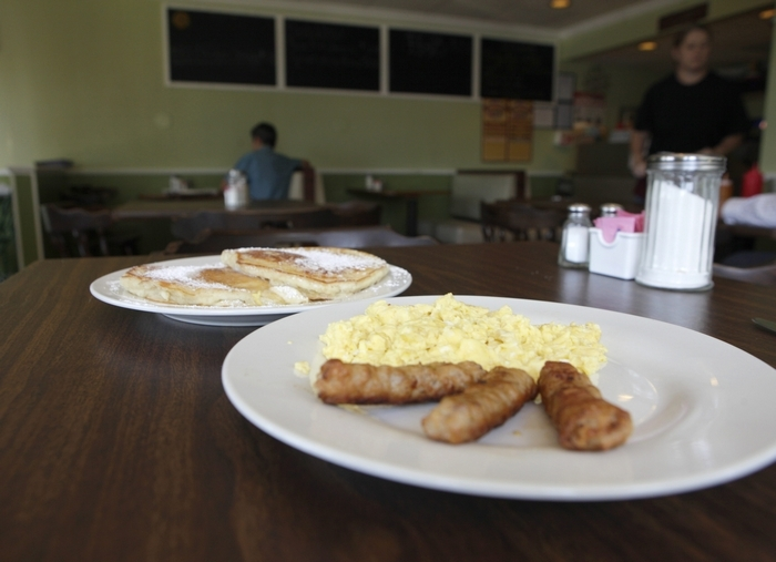 A No. 7 with sausage, eggs and two pancakes is ready to be served at the Kitchen Table Family Restaurant on Elmwood Avenue. (Matthew Masin/Buffalo News)