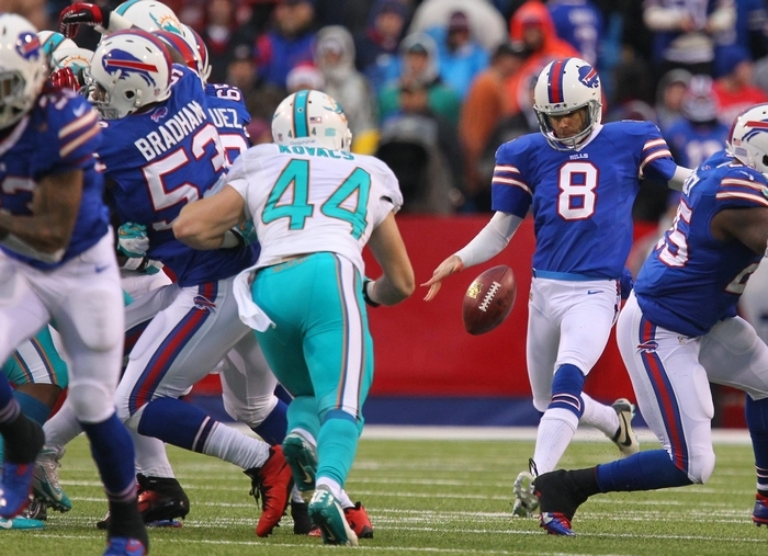 The Bills' Brian Moorman (8) punts the ball in the 4th quarter against the Miami Dophins at Ralph Wilson Stadium in Orchard Park on Dec. 22. (Mark Mulville/Buffalo News)