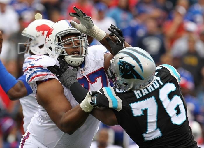 The Bills' Cordy Glenn, blocking Carolina's Greg Hardy, uses his size and unflappability to neutralize opponents. (Mark Mulville/Buffalo News)