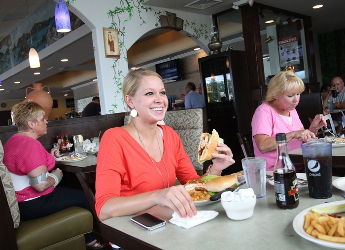 Samantha McGrath, left, and her mother Sara Gentile (not pictured) have lunch at the Olive Branch on Union Rd. in West Seneca, Thursday, Aug. 1, 2013.  (Sharon Cantillon/Buffalo News)