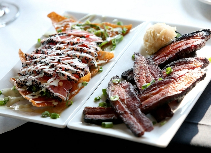 The House Smoked Bacon app, right, and the Ahi Tuna Nachos app left, at the Riverstone Grill in Grand Island on Wednesday, Dec. 4, 2013.  (Robert Kirkham/Buffalo News)