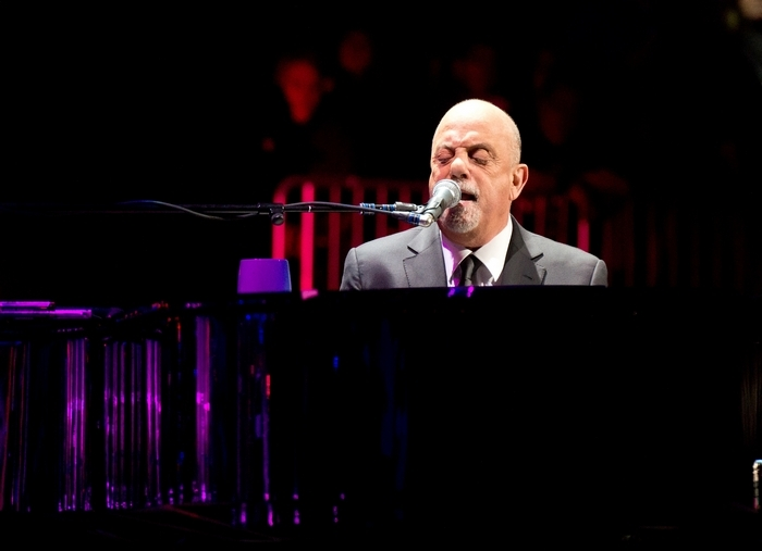 Billy Joel performs at Barclays Center on New Year's Eve. The Piano Man's next move is a residency at Madison Square Garden, where he will monthly beginning Jan. 27. (Getty Images)