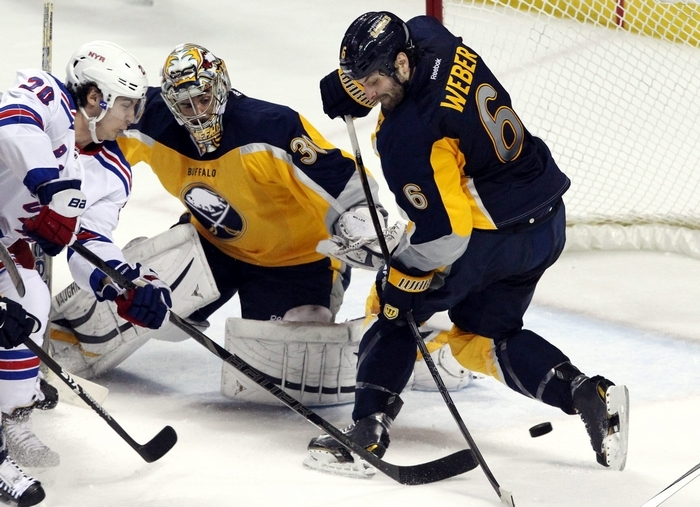 Buffalo Sabres goalie Ryan Miller (30) and defenseman Mike Weber (6) make a save on a shot from New York Rangers left wing Chris Kreider (20) in the second period at the First Niagara Center in Buffalo on Thursday.  (James P. McCoy/ Buffalo News)