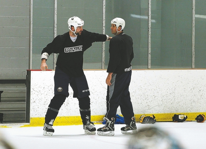 "Buffalo Sabres John Scott, left, and retired Sabres enforcer Andrew Peters practice ""fighting"" during a workout session last year. While Peters made a good living as a fighter on the ice, he wouldn't do the same role again if he had a chance to do it all over again. {Photo by Charles Lewis / Buffalo News File photo}"