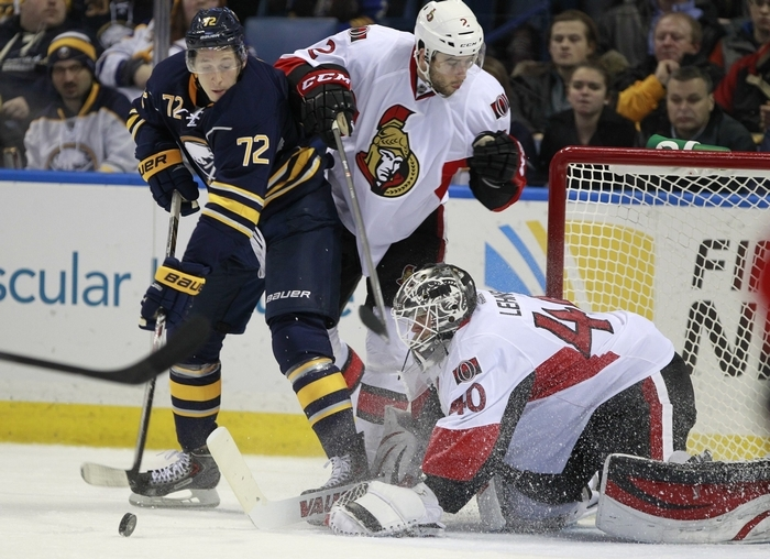 Buffalo Sabre , Luke Adam (72) tries to be Ottawa Senator goaltender, Robin Lehner (40) during second period action at the First Niagara Center,on,Tuesday, Dec. 10, 2013(Harry Scull Jr./Buffalo News)