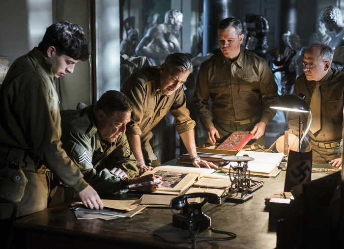 "This image shows, from left, Sam Epstein, John Goodman, George Clooney, Matt Damon and Bob Balaban in a scene from ""The Monuments Men."""