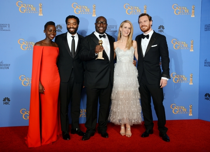 "From left, Lupita Nyong'o, Chiwetel Ejiofor, Steve McQueen, Sarah Paulson and Michael Fassbender pose in the press room with the award for best motion picture – drama for ""12 Years a Slave"" at the 71st annual Golden Globe Awards at the Beverly Hilton Hotel on Sunday, Jan. 12, 2014, in Beverly Hills, Calif. (Photo by Jordan Strauss/Invision/AP)"