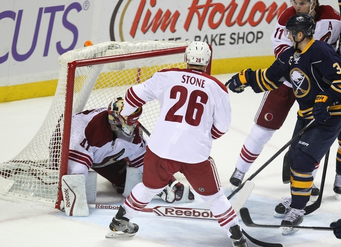The Sabres' Mark Pysyk points to where the puck is on the game-winning goal Monday at First Niagara Center: In the back of the pants of the Coyotes' Mike Smith. (Mark Mulville/Buffalo News)