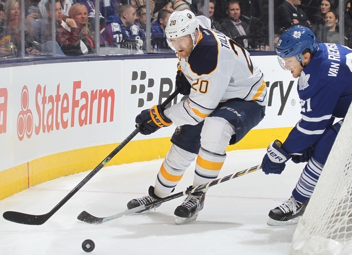 Buffalo's Henrik Tallinder skates away from Toronto's James van Riemsdyk at the Air Canada Centre Friday. (Getty Images)