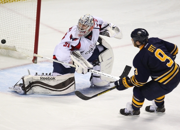 Sabres captain Steve Ott scores the shootout winner past the Capitals goalie Philipp Grubauer. (Mark Mulville/Buffalo News)