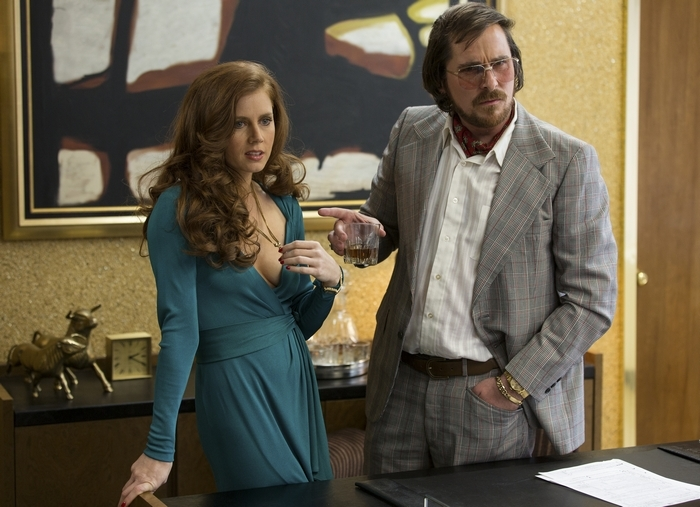 """Amy Adams, left, and Christian Bale in a scene from """"American Hustle,"""" which took the Screen Actors Guild's top honor for outstanding cast at Saturday's presentation."""