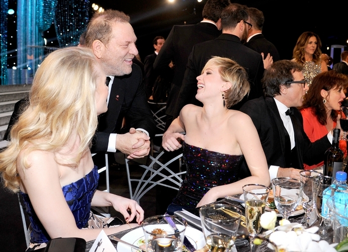 Producer Harvey Weinstein chats with actress Jennifer Lawrence in the audience during the 20th annual Screen Actors Guild Awards Saturday in Los Angeles. (Getty Images)