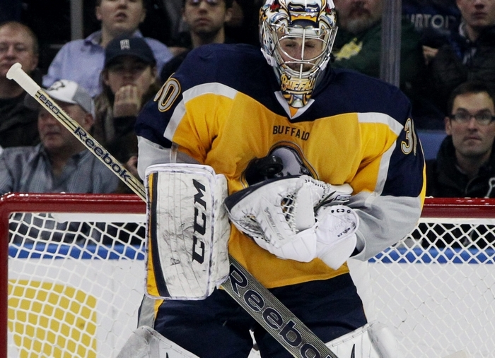 Sabres goalie Ryan Miller makes a save in the first period of Saturday's game. (James P. McCoy/Buffalo News)