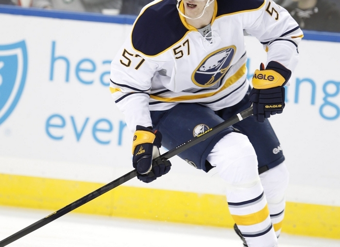 Tyler Myers may get fined or suspended after the NHL reviews his hit on New Jersey's Dainius Zubrus. (Harry Scull Jr./Buffalo News)