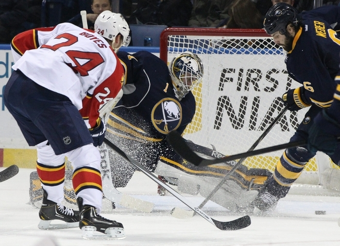 Jhonas Enroth made this save against Brad Boyes, but couldn't stop him in the shootout. (James P. McCoy/Buffalo News)