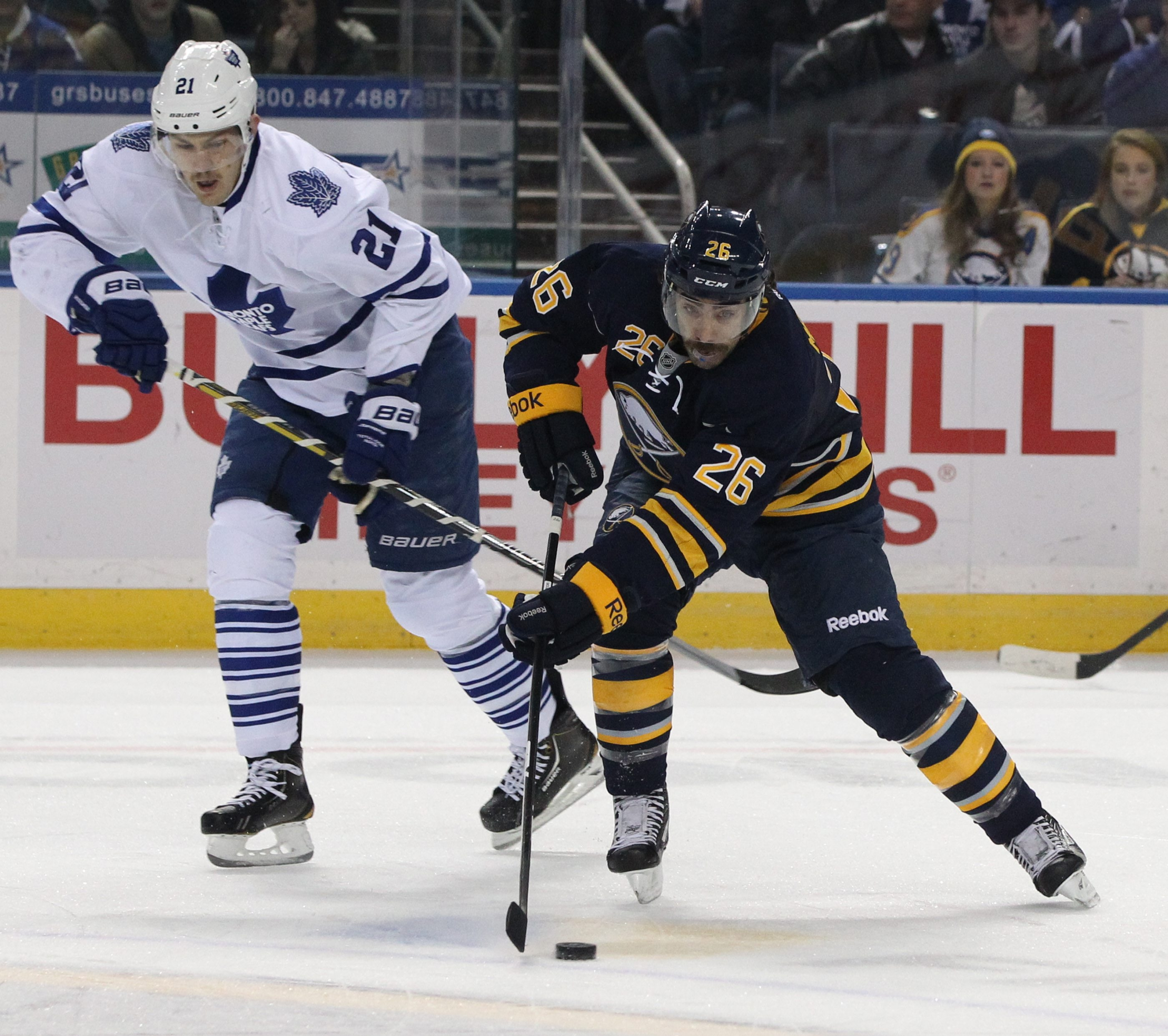 Buffalo Sabres left wing Matt Moulson (26) skates with the puck past Toronto Maple Leafs left wing James van Riemsdyk (21) in the first period at the First Niagara Center in Buffalo,NY on Friday, Nov. 29, 2013.  (James P. McCoy/ Buffalo News)