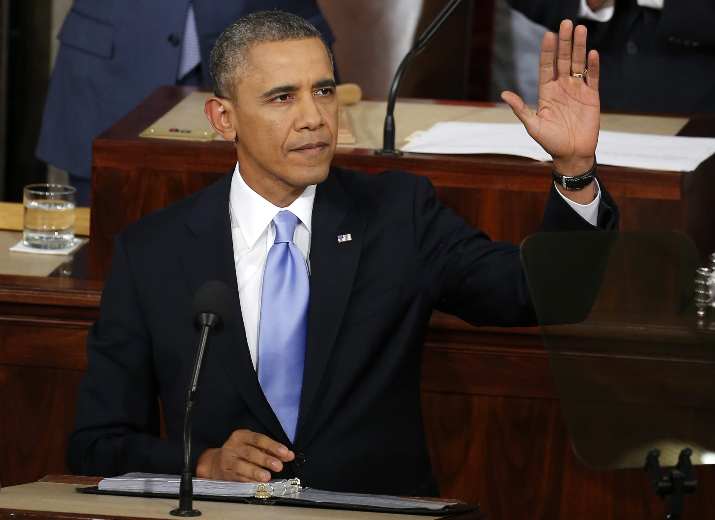 President Obama acknowledges the applause from members of Congress and others before giving his State of the Union Address at the Capitol in Washington, D.C. on Tuesday.