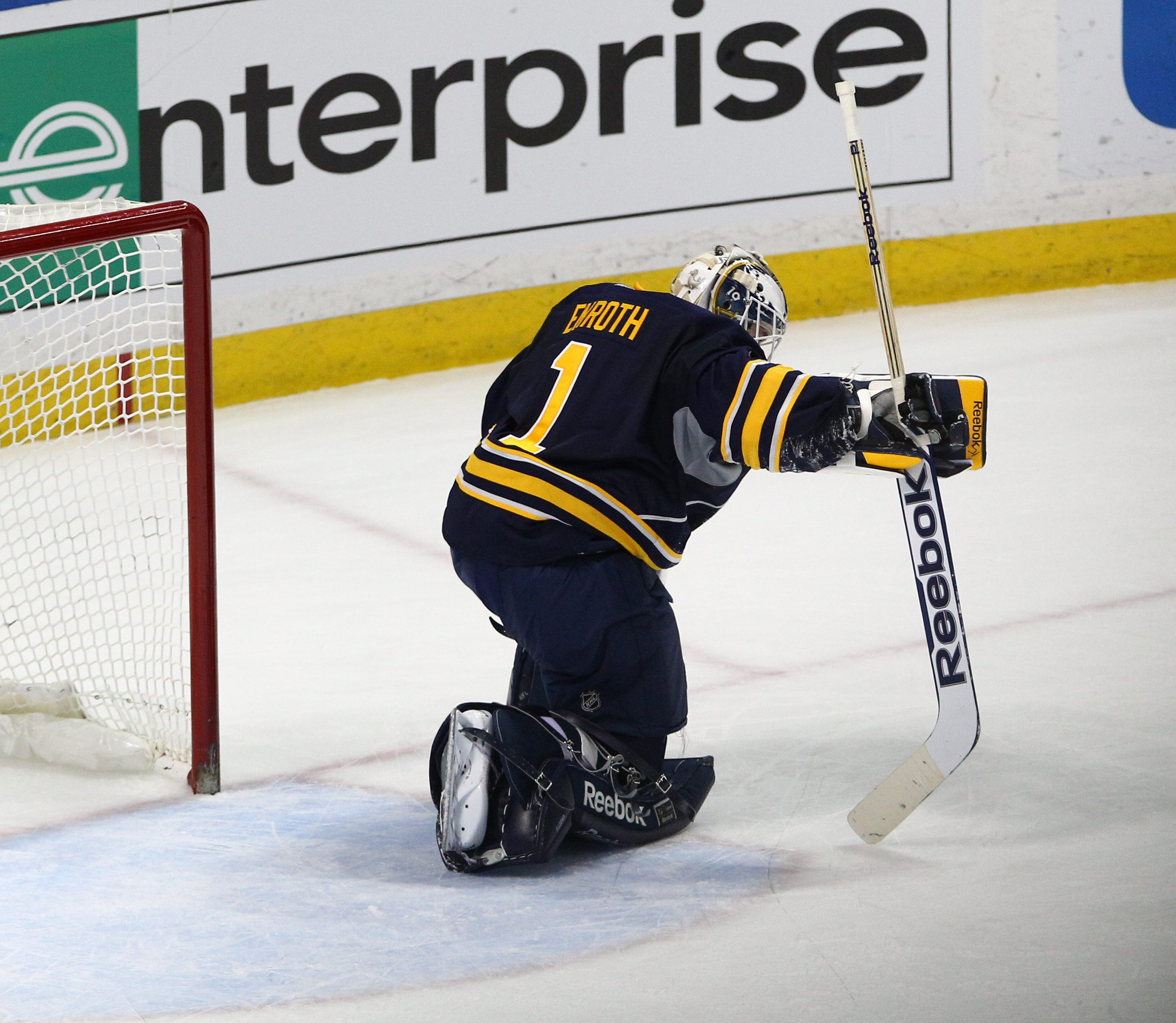 Jhonas Enroth slumps after giving up the game-winning goal in overtime to Mike Green.