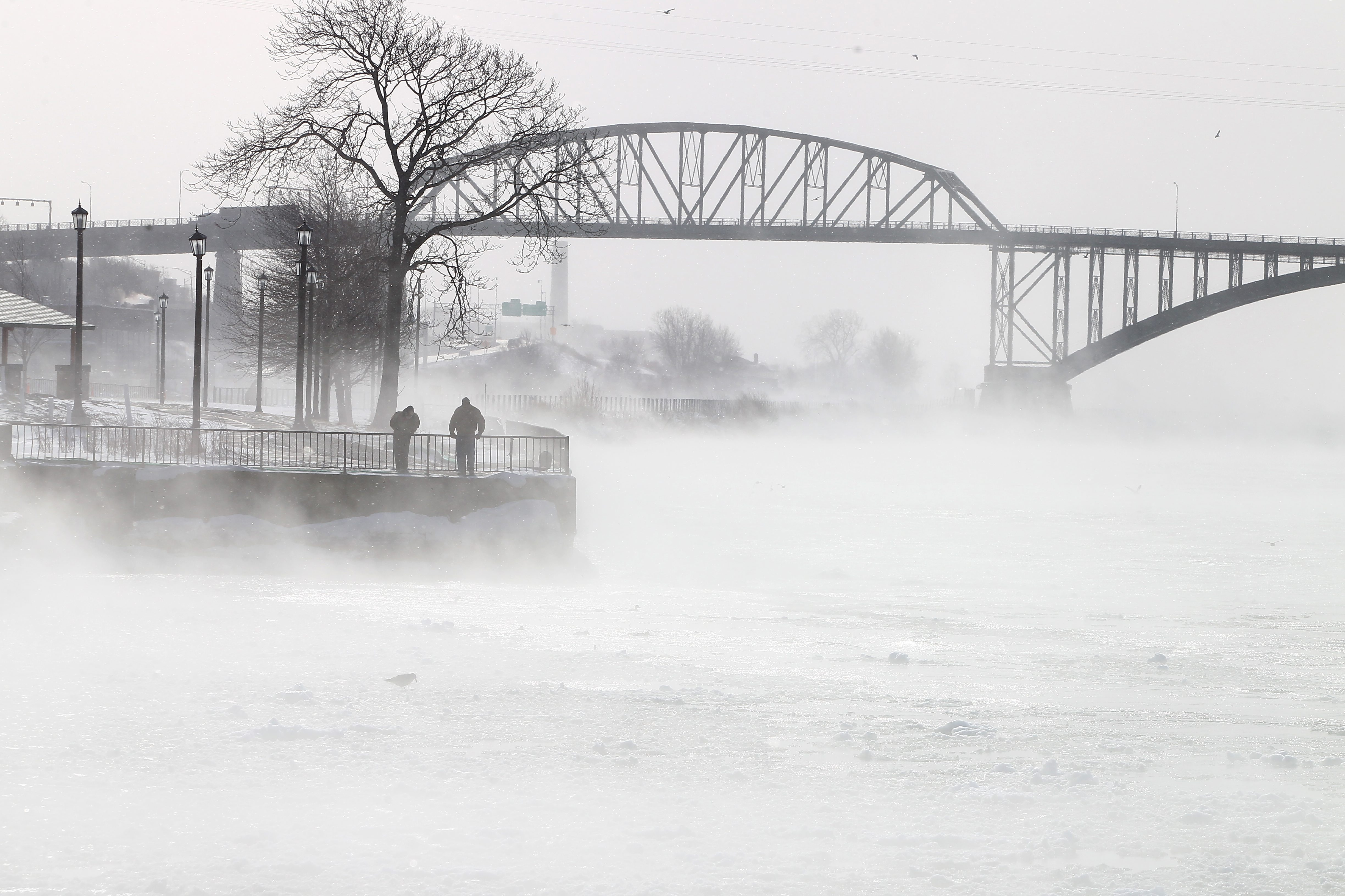 Mist rises from Niagara River as seen at Broderick Park, as fishermen check for minnows, in Buffalo on Tuesday.