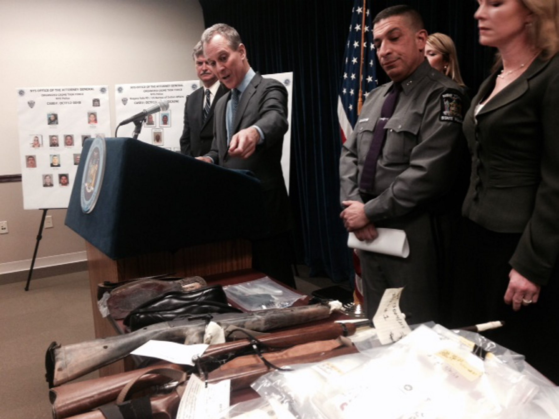 State Attorney General Eric Schneiderman gestures to a table of evidence during a news conference Tuesday announcing a major drug bust.