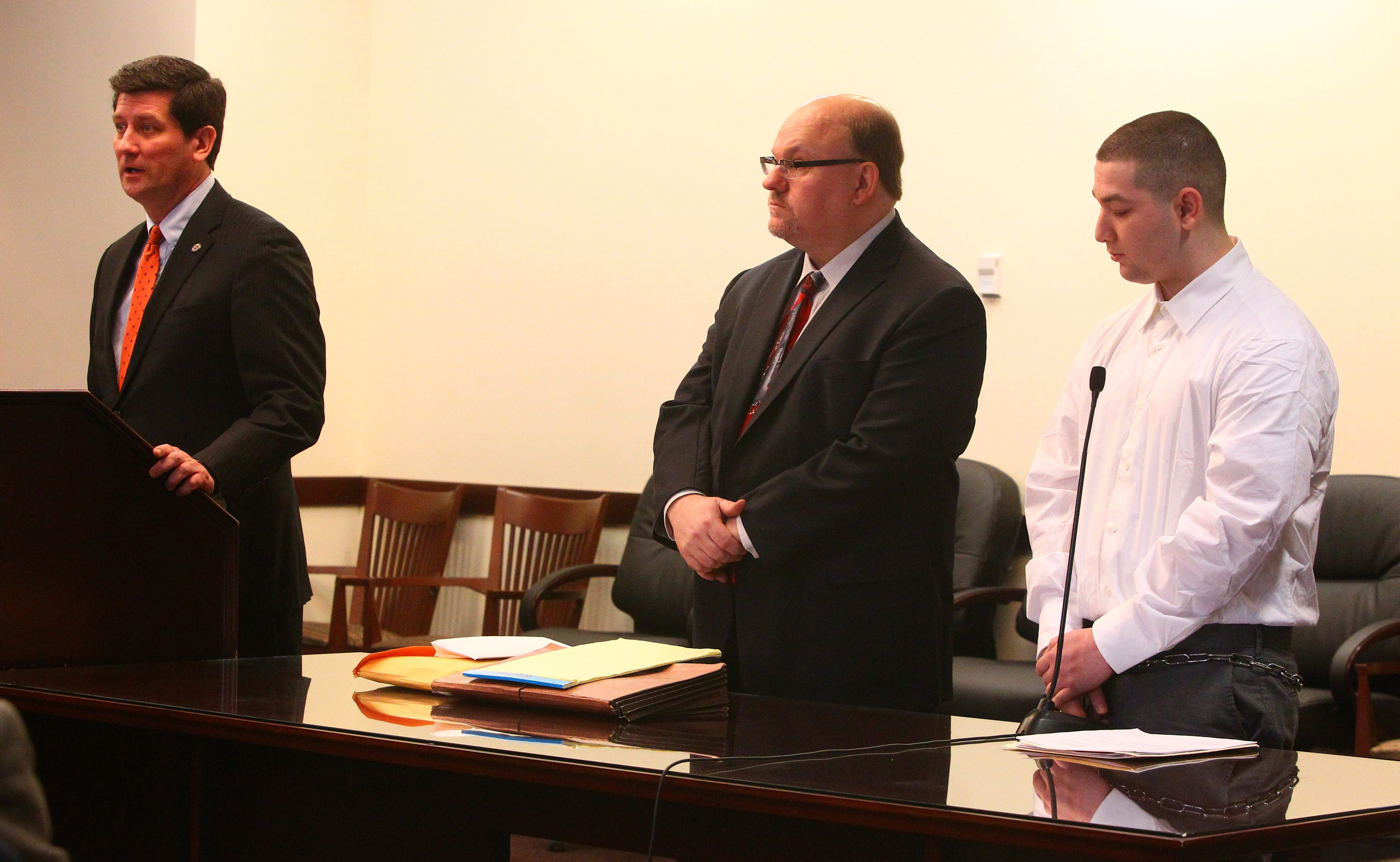 Erie County Executive Mark Poloncarz, left, testifies at the courtroom sentencing of Avello Pena, right, as attorney Frank Bybel, center, listens. Pena pleaded guilty to breaking into Poloncarz's car and home Tuesday and was sentenced to eight years in prison.